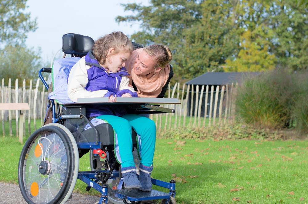 Mother talks to girl with communication disability